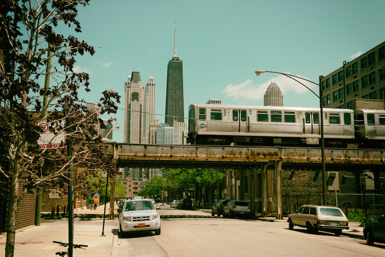 Metra elevated train in front of Chicago skyline